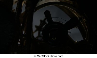 Metal cogwheels inside clockwork. Close up