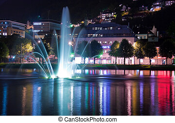 Night pond with fountain in Bergen