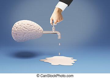 Brain drain hand - Brain drain concept with businessman hand...