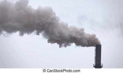 Smoke, steam from the pipes above the metallurgical...