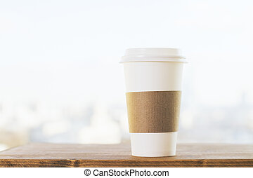 Coffee on blurry background - Plastic coffee cup on wooden...