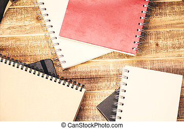 Notepads on desktop - Topview of wooden surface with...