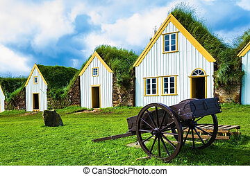 Old wooden two-wheeled carriage - The village first settlers...