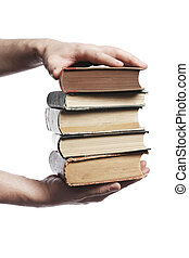 Old knowledge - Man carrying a stack of book in his hands