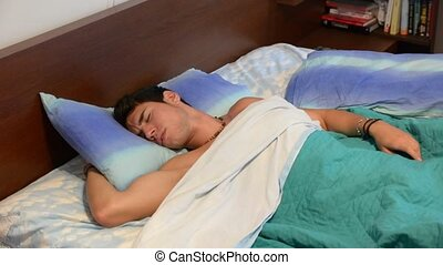 Young Man Sleeping, Having Nightmares - Three Quarter Shot...