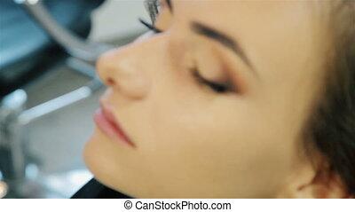Beautiful young girl doing makeup