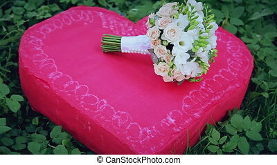 Wedding bouquet on a red heart HD