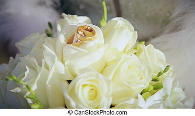 Bouquet of wedding rings in hands of bride
