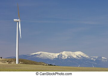 wind energy - wind mill and snowy mountain with blue sky