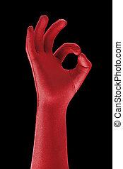 OK - a strange red gloved hand doing OK sign