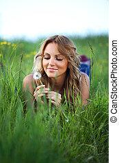 i wish - girl blow on dandelion on green field