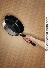 Saute pan - Man holding a saute pan.