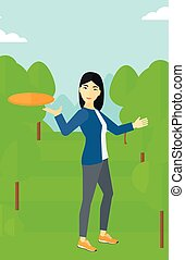 Woman playing flying disc. - An asian woman playing flying...