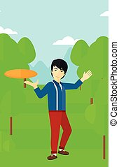 Man playing flying disc - An asian man playing flying disc...