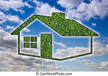 Green Grass House Icon over Sky and Clouds