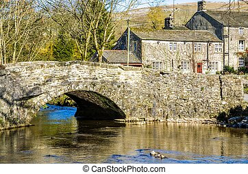 Malham village in North Yorkshire - Stone bridge over a...
