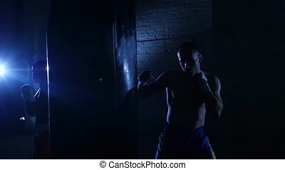 Punching boxing bag with glove Slow motion - Punching boxing...