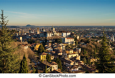 View over Citta Alta or Old Town buildings in the ancient city of Bergamo, Lombardia, Italy on a clear day, taken from San Virgilio point.