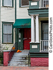 Pumpkins on Old Porch by Red Door