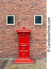 Red postbox in Netherlands. - Old red postbox in front of...