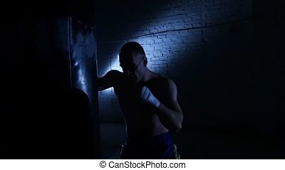 Boxer punching in boxing ring. Slow motion - Training with a...