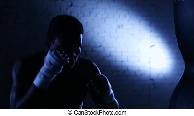 African american boxer athlete punching and shadow boxing in...