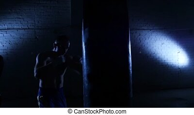 Boxer shadow boxes in the gym Slow motion - Boxing training,...