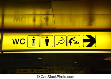 Toilets sign - yellow public toilets WC sign men, women,...