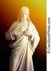 Jesus Christ statue with sun beam