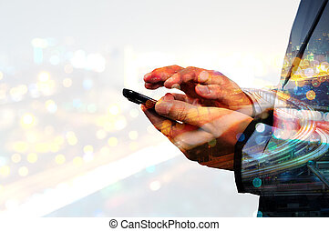 Double exposure of Business Man use Mobile SmartPhone with...