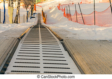 Moving walkway in snow