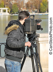 Man with professional camera taking video