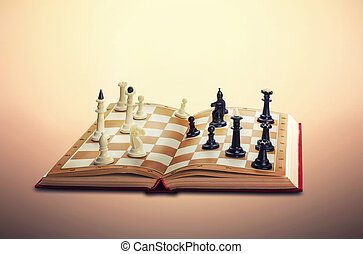 Chess figures standing in the opened book