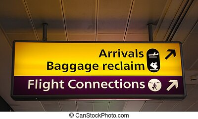 Informational signs at the airport - yellow arrivals/baggage...