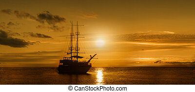 Panoramic image of the ship on a sunset background