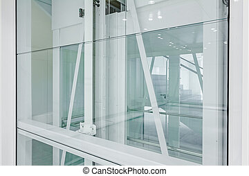 View on new elevator. - Transparent walls in elevator and...