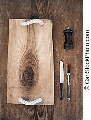 Kitchen-ware set. Old rustic serving board tray, knive and...