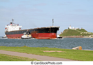 Freighter ship - Cargo ship being escorted to the Newcastle...