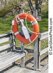 Lifebuoy on a rustic wooden jetty