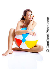 Beach ball girl - Beautiful young woman posing in bikini...
