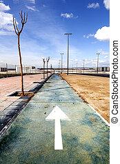 Cycleway and arrow painted on floor - Urban scene Bike path...