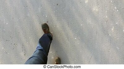 Men feet shoes walking on the asphalt in city - Men feet in...