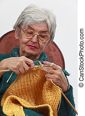 Old woman knitting - Image of an old woman knittingSelective...