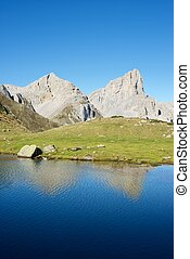 Pyrenees - Peaks reflected in Ansabere Lake. Lescun Cirque....