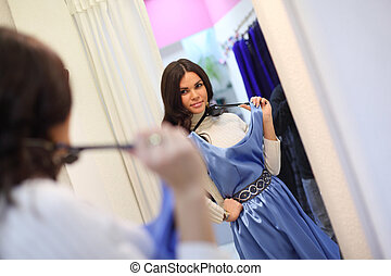 in dressroom  - woman in dress room wear dress