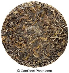 Young raw puerh cake isolated overhead view