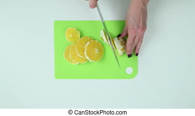 Slice the oranges with a knife - Orange cut into slices on a...