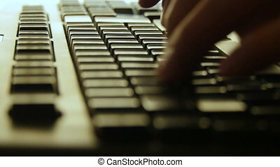 Fingers typing keyboard night late work computer close up