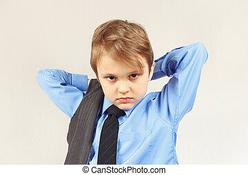 Little stylish boy wears on suit jacket - Little stylish boy...