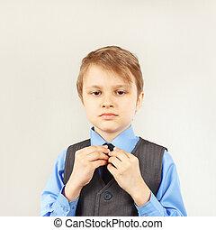Little cute gentleman dresses his suit jacket - Little cute...